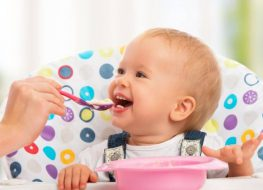 little spoon baby food feeding a smiling baby